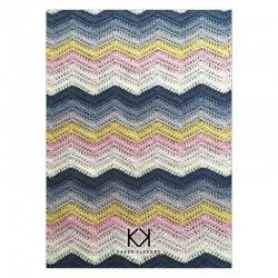 Opskrift på ZigZag-tæppe. Farvetryk i postkortstørrelse.